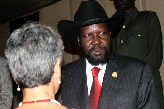 President Salva Kiir chatting with a diplomat after his speech at J-One