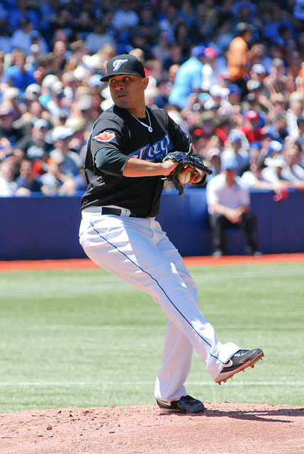 Jays pitcher Ricky Romero sets his sights at home plate while getting ready to throw a pitch