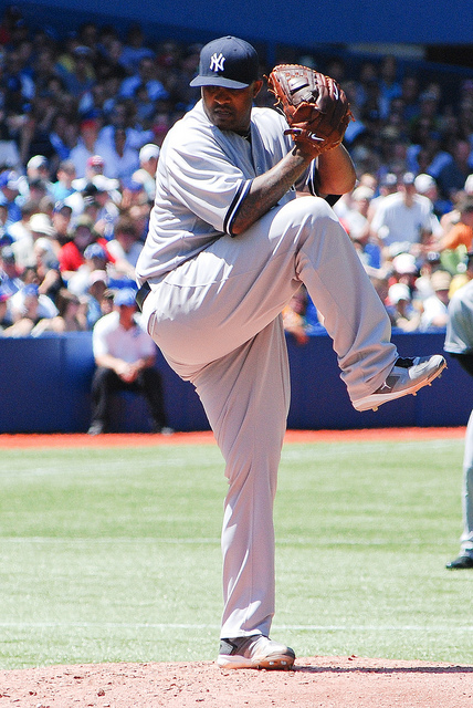 Yankees pitcher CC Sabathia winds up to deliver a pitch