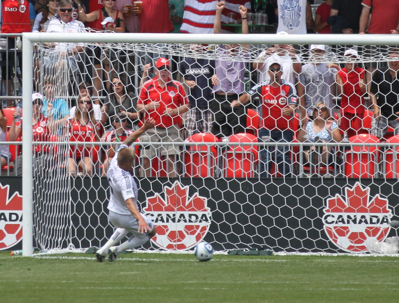 Whitecaps defender Jay DeMerit makes a great effort to clear the ball off the line in the first half