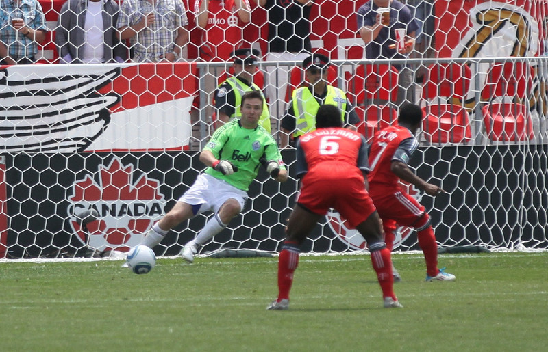 Plata gets Whitecaps goalkeeper Joe Cannon going the wrong way to score on his second attempt on a penalty kick in the second half