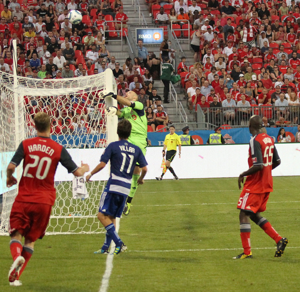 TFC goalkeeper Stefan Frei swipes an attempted cross out of bounds in the dying seconds of the first half