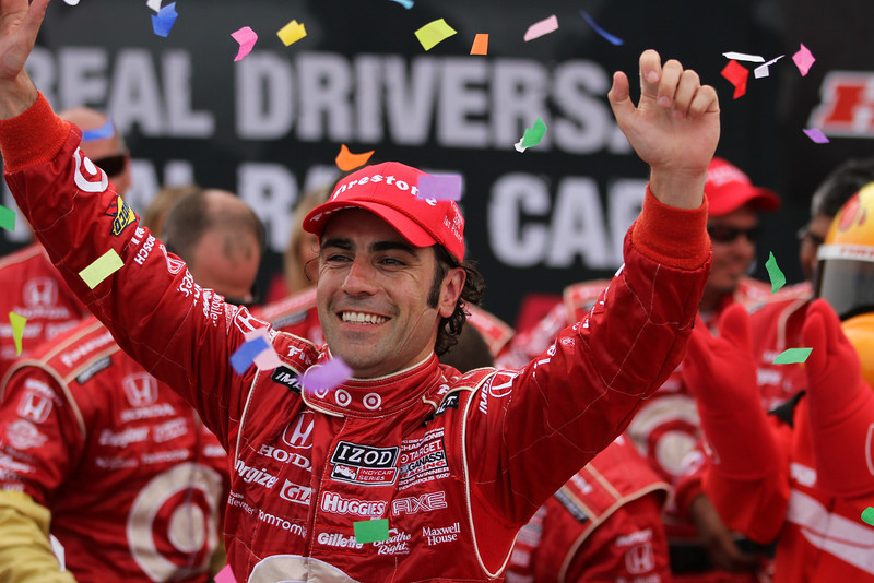 Dario Franchitti raises his arms in celebration after winning Honda Indy Toronto