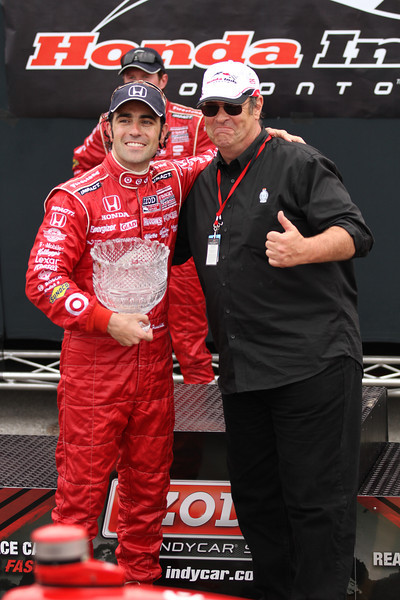Canadian actor Dan Ackroyd (right) presents Franchitti with the trophy