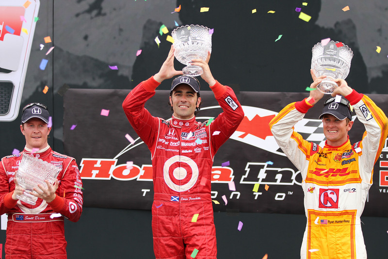 Scott Dixon (left), Franchitti (centre) and Ryan Hunter-Reay (right) show off their hardware from the podium