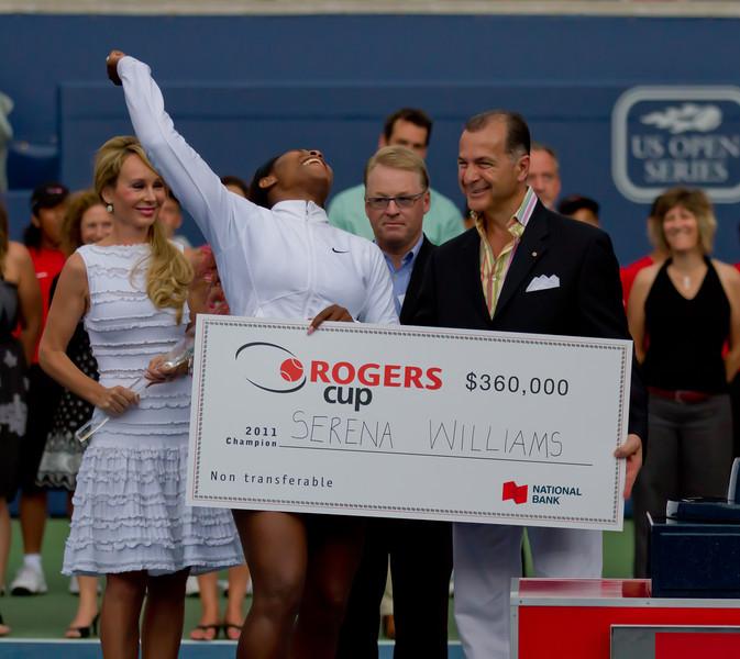 Williams celebrates her tournament winnings
