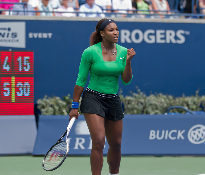Williams with her trademark fist pump looks very focused in her celebration of a winning point