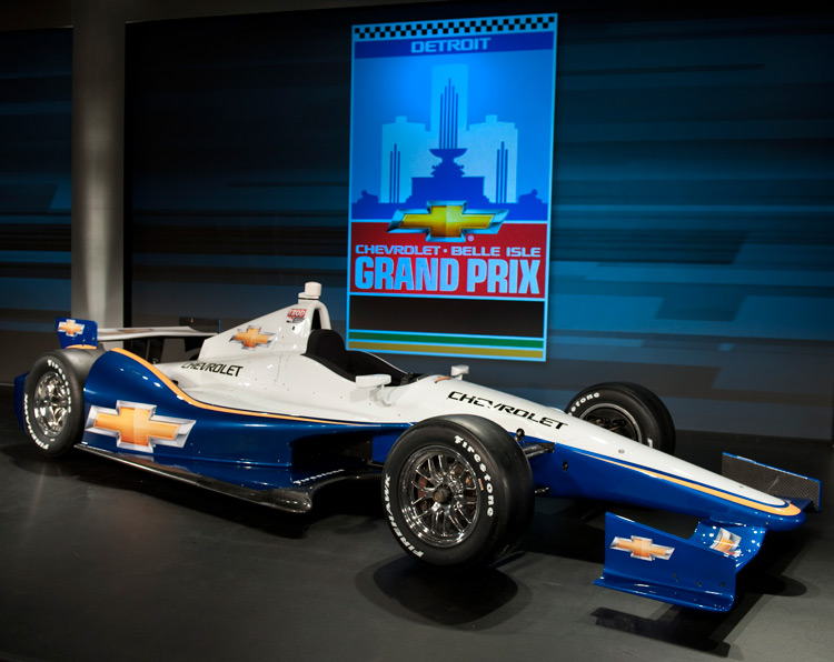The all new 2012 Chevrolet IndyCar. New Detroit Grand Prix logo in background.