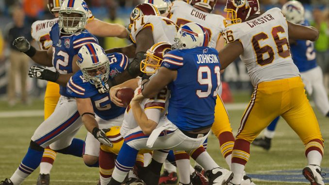 Washington Redskins quarterback John Beck is sacked by Buffalo Bills linebacker Danny Batten and defensive end Spencer Johnson at Rogers Centre Sunday (John Lucero)