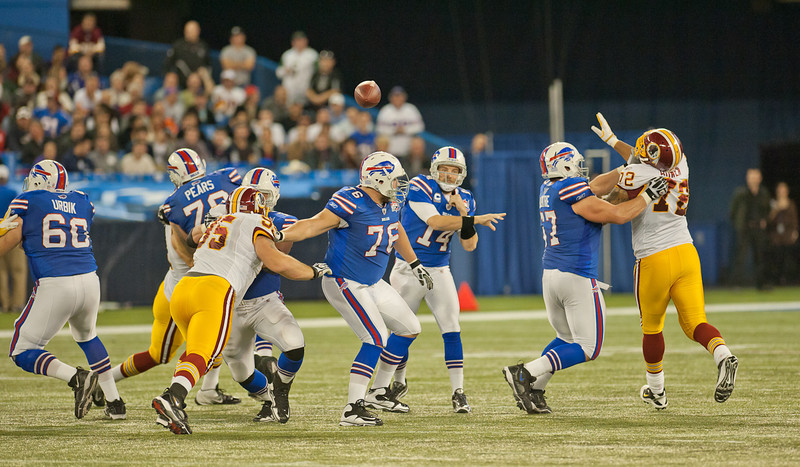Bills quarterback Ryan Fitzpatrick throws the football up the middle (John Lucero)