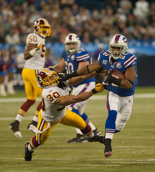Bills running back Fred Jackson throws a sidearm at Redskins safety LaRon Landry (John Lucero)