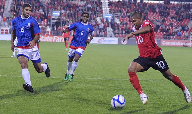Canadian striker Simeon Jackson (right) pushes the ball forward as Puerto Rican defenders close in on him (Karan Vyas)