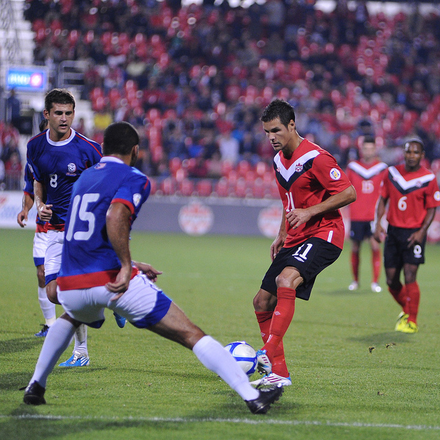 Canadian midfielder Josh Simpson (right) ponders his options while being watched by defenders Cristian Arrieta (left) and Scott Horta (centre) (Karan Vyas)