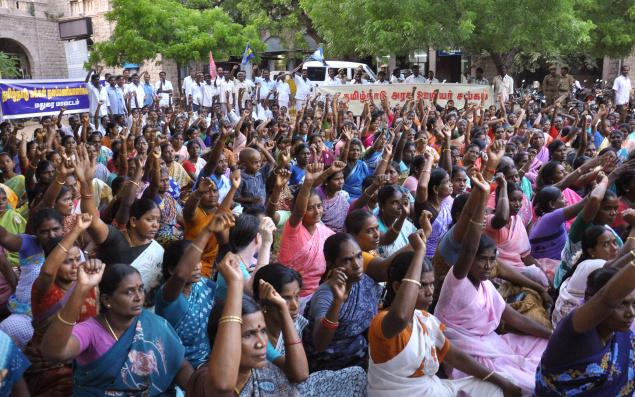 Women staging a demonstration in front of the collectorate in Madurai