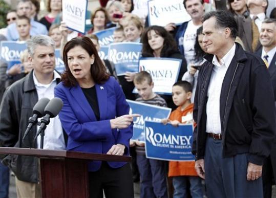 Mitt Romney looks on as Sen. Kelly Ayotte, R-N.H., endorse him outside City Hall in Nashua, N.H., Sunday, Nov. 20, 2011.