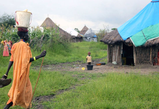 A woman in Pibor County walking home from her garden [©Gurtong]