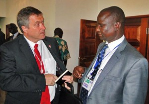 Unity State Governor Taban Deng Gai (right) confers with a guest at the ongoing Governors' Forum in Juba. [©Gurtong]