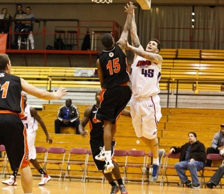 Oshawa Power guard Brandon Robinson jumps up to contest a shot from the Quebec Kebs
