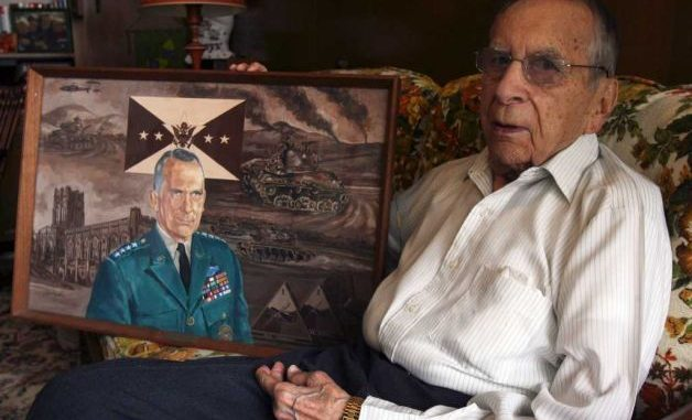 Retired Gen. Ralph E. Haines Jr. posed in 2010 with a portrait