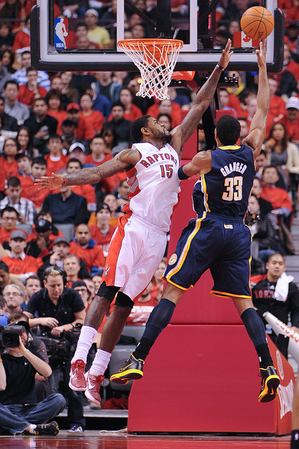 Raptors forward Amir Johnson reaches out in attempt to block a hook shot from Pacers forward and leading scorer Danny Granger (Karan Vyas)