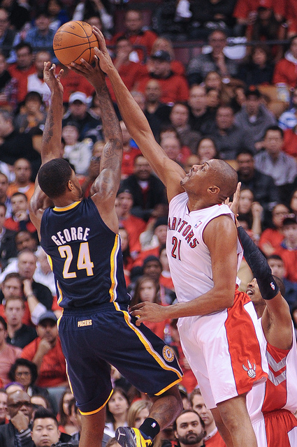 Pacers guard Paul George has his shot blocked by Raptors centre Jamaal Magloire who made his home debut as a Raptor (Karan Vyas)