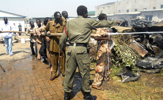 Rescuers and fire brigade team saving properties from being burnt at the Beijing Juba Hotel [©Gurtong]