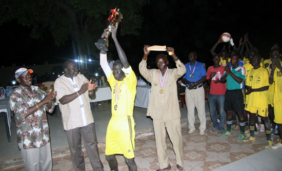 Gazal united football team wins the Lakes Governor Cup match as the captain raises the Trophy high [©Gurtong]
