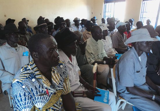 Chiefs follow the Commissioner's message during the opening of the workshop in Kapoeta North County [©Gurtong]