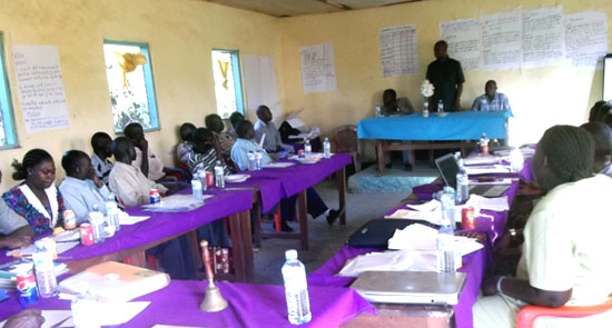 Participants listening to the Project Analyst during the county strategy workshop [©Gurtong]