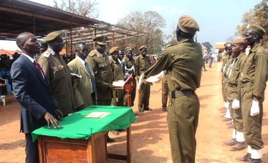 Governor Banagasi Joseph Bakosoro (wearing a suit) and other Prison officers awards certificates to the new prison warders [©Gurtong]