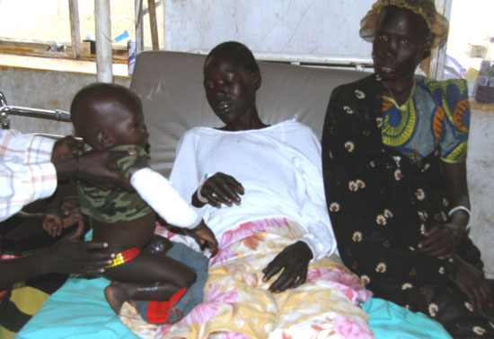 A wounded woman and her child being attended at a health centre in Jale Payam of Bor County [©Gurtong]