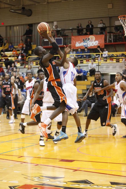 Oshawa Power point guard Tut Ruach pulls up for a jumper during a loss to the Quebec Kebs at Laval University on Friday night.