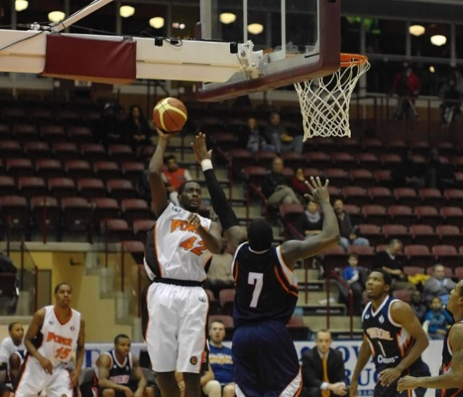 Oshawa Power forward Omari Johnson puts up a hook shot during a closely contested game against the Summerside Storm on Thursday night at the GM Centre in Oshawa.