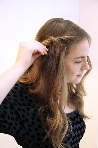 3. Use a bobby pin to secure the twist at the side of your head, just above your ears.