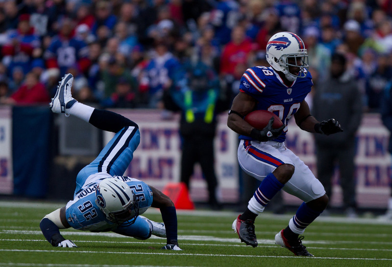Titans linebacker Will Weatherspoon falls to the ground after failing to tackle Spiller (JP Dhanoa)