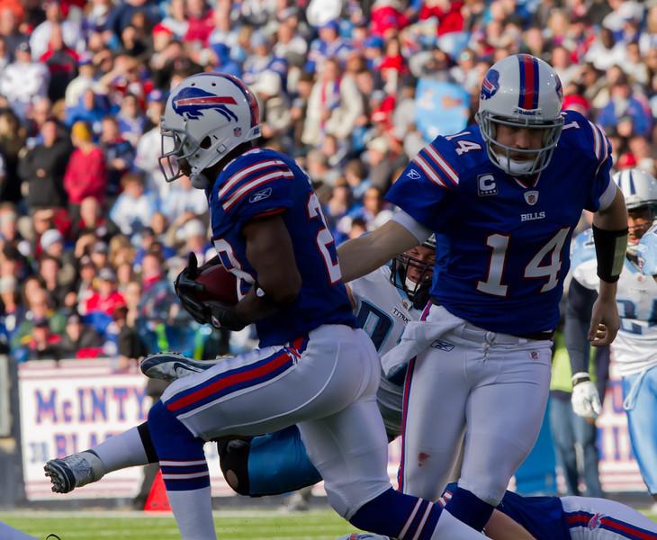 Bills quarterback Ryan Fitzpatrick hands the ball off to running back C.J. Spiller (JP Dhanoa)