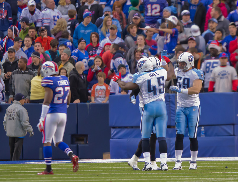 Titans fullback Ahmard Hall (45) and linebacker Tim Shaw (59) congratulate Johnson after his second touchdown of the game (JP Dhanoa)