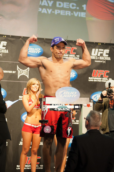 Machida gets weighed on the scale a day before his fight with Jones for the light-heavyweight title at UFC 140 (John Lucero)