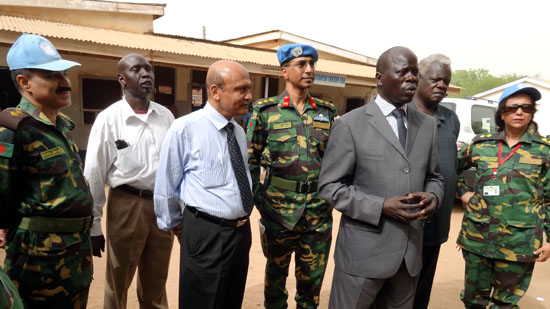 Hastin Yokwe Anisio (wearing a suit) addressing the media and behind him is the Commanding Officer of Bangladesh Level II Hospital [©Gurtong]