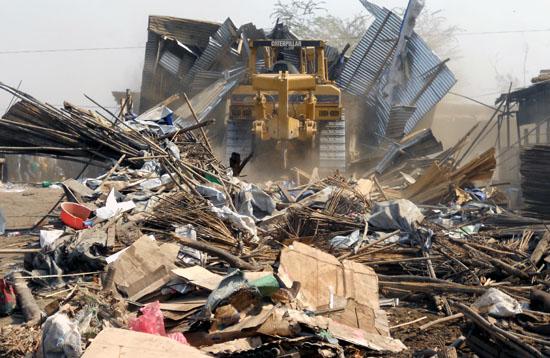 A bulldozer demolishing parts of Konyokonyo market to pave way for new constructions [©Gurtong]