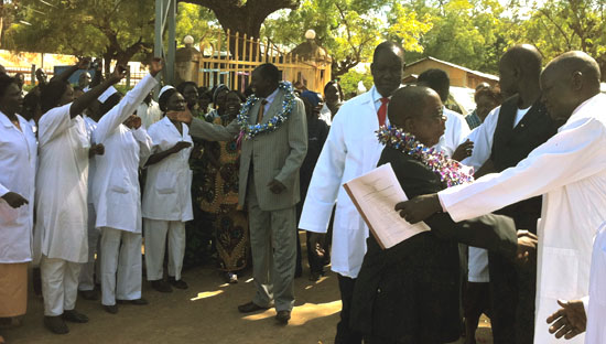 Dr Michael Milly Hussein and Dr Yatta Lugor shaking hands with the doctors and nurses during a past event