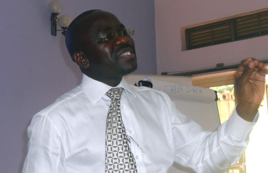 Mr. Godbar W. Tumushabe addressing journalists at the African Centre for Media Excellence in Uganda