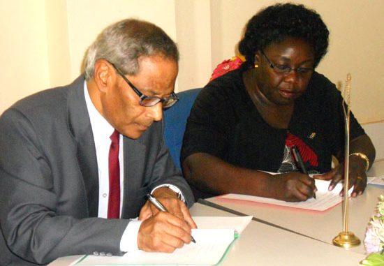 (L-R) The Consul General of India, Parimal Kar and Hon. Beatrice Khamisa Wani signing the MoU in Juba [©Gurtong]