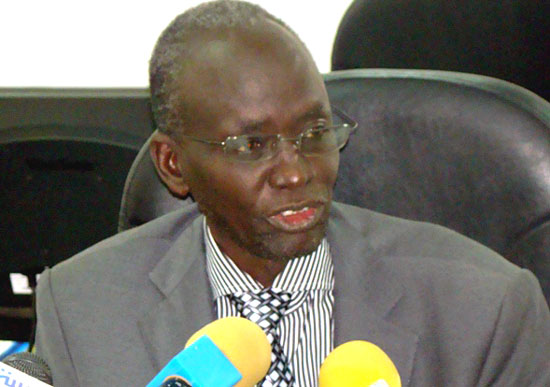 Mr. Isaiah Chol briefing the press about the commissions' 2014 plans [©Gurtong]