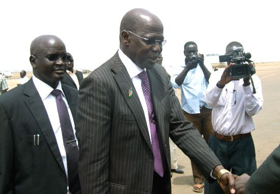 Governor Simon Kun Puoch (shaking hands) arrives at the Juba International Airport [©Gurtong]