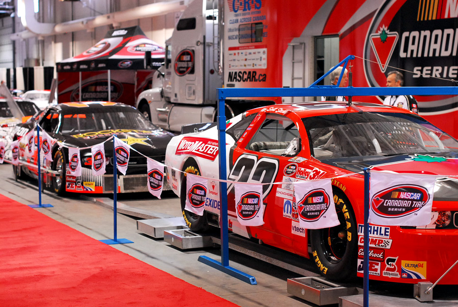 Stock cars on display by Canadian Tire