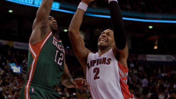 Toronto Raptors forward James Johnson (right) drives hard to the basket against Milwaukee Buck forward Luc Mbah a Moute on Wednesday night at the Air Canada Centre (JP Dhanoa)
