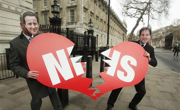 Protesters demonstrating the opposition on NHS Bill