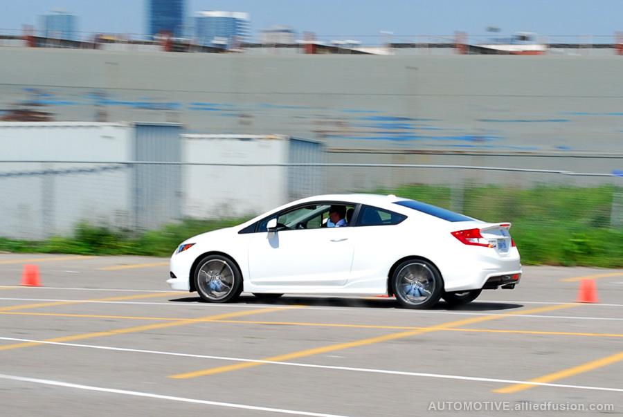 Honda Civic Si HFP driven through a mini-circuit set up at Polson Pier in Toronto