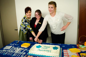Voices For Change members are cutting the Cake on their first annual celebration
